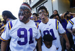 Vili Fehoko, left, father of LSU defensive end Breiden Fehoko, makes a face after family members greeted his son with a haka, a Maori ceremonial dance, as the team arrived at Tiger Stadium before an NCAA college football game against Alabama in Baton Rouge, La., Saturday, Nov. 3, 2018. (AP Photo/Gerald Herbert)