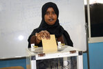 A Djiboutian casts her vote in the presidential election, in the capital Djibouti city, Djibouti Friday, April 9, 2021. The Horn of Africa country of Djibouti is going to the polls on Friday as President Ismail Omar Guelleh seeks a fifth term in the small but strategically important nation home to military bases for the United States, China and others. (AP Photo/Mahad Mohamed)