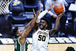 Purdue forward Trevion Williams (50) shoots over Michigan State forward Julius Marble II (34) during the second half of an NCAA college basketball game in West Lafayette, Ind., Tuesday, Feb. 16, 2021. (AP Photo/Michael Conroy)