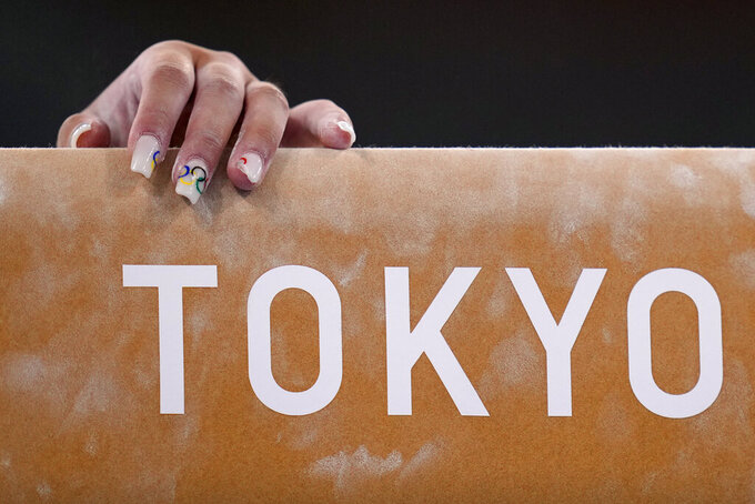 Jordan Chiles, of the United States, trains on the beam during an artistic gymnastics practice session at the 2020 Summer Olympics, Thursday, July 22, 2021, in Tokyo, Japan. (AP Photo/Gregory Bull)