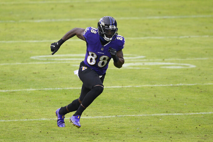 Baltimore Ravens wide receiver Dez Bryant runs a route against the Jacksonville Jaguars during the second half of an NFL football game, Sunday, Dec. 20, 2020, in Baltimore. (AP Photo/Nick Wass)