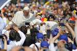 Pope Francis arrives to celebrate a Divine Liturgy and the beatification of seven martyred bishops of the Eastern-rite Romanian Catholic Church, in Blaj, Romania, Sunday, June 2, 2019. Francis was traveling across Romania to visit its far-flung Catholic communities to make up for the fact that St. John Paul II was only allowed to visit the capital, Bucharest, in 1999 in the first papal visit to a majority Orthodox country. (AP Photo/Vadim Ghirda)