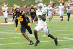 North Texas wide receiver Roderic Burns, right, scores a touchdown past Missouri linebacker Joe Britton, left, during the fourth quarter of an NCAA college football game Saturday, Oct. 9, 2021, in Columbia, Mo. (AP Photo/L.G. Patterson)