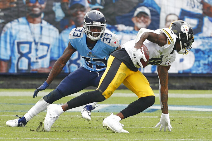 Pittsburgh Steelers wide receiver Diontae Johnson (18) gets past Tennessee Titans cornerback Johnathan Joseph (33) as Johnson scores a touchdown in the first half of an NFL football game Sunday, Oct. 25, 2020, in Nashville, Tenn. (AP Photo/Wade Payne)