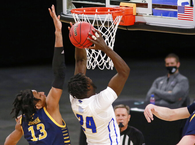 UC Santa Barbara's Robinson Idehen (24) goes for a shot around UC Irvine's Austin Johnson (13) during the first half of an NCAA college basketball game for the championship of the Big West Conference men's tournament Saturday, March 13, 2021, in Las Vegas. (AP Photo/Ronda Churchill)