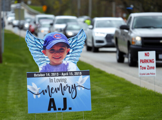 FILE - In this May 3, 2019, file photo, cars line up as mourners head to visitation services for AJ Freund at Davenport Funeral Home in Crystal Lake, Ill. McHenry County Judge Robert Wilbrandt ruled Tuesday, July 14, 2020, that media must not publish or broadcast images of autopsy photographs of the 5-year-old boy during the sentencing hearing of his mother, who has pleaded guilty in his murder. Wilbrandt agreed with the prosecutor's objection to letting the five photographs or videos to be photographed or shown on television as part of the coverage of JoAnn Cunningham's sentencing that starts Thursday. (Brian Hill/The Daily Herald via AP, File)