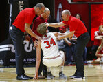 Utah center Jayce Johnson (34) is helped to his feet during the second half of the team's NCAA college basketball game against Washington on Thursday, Jan., 10, 2019, in Salt Lake City. (AP Photo/Rick Bowmer)