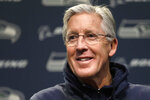 "Seattle Seahawks coach Pete Carroll smiles as he addresses a news conference Tuesday, Dec. 24, 2019, in Renton, Wash. When it comes to NFL reunions, this is as unlikely as it gets. Not just Marshawn Lynch back on a football field after more than a year away, but being back in Seattle. ""What I needed to hear from him is where his heart is. Is he in it and does he want to go for it, which he totally does,"" Carroll said. ""He's worked to prove that. I don't doubt him one bit about that. He's very sincere about how he presents himself to this game and it's very important to him to be at his best and do well, and he's going to do everything he can to make that happen."" (AP Photo/Elaine Thompson)"