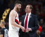 Portland Trail Blazers center Jusuf Nurkic, left, talks with Portland Trail Blazers head coach Terry Stotts as the Blazers beat the Brooklyn Nets in double overtime, 148-144, during an NBA basketball game in Portland, Ore., Monday, March 25, 2019. (AP Photo/Randy L. Rasmussen)
