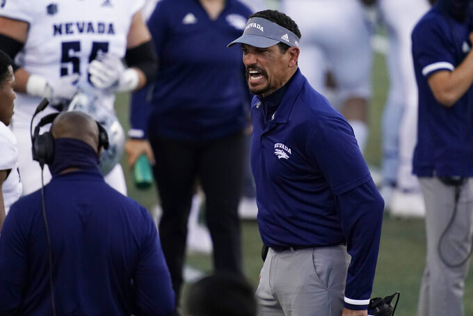 Nevada head coach Jay Norvell yells at a player during the first half of an NCAA college football game against New Mexico, Saturday, Nov. 14, 2020, in Las Vegas. (AP Photo/John Locher)