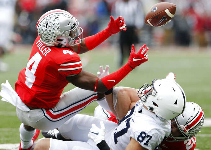 Ohio State defensive back Jordan Fuller, left, breaks up a pass intended for Penn State tight end Pat Freiermuth during the first half of an NCAA college football game Saturday, Nov. 23, 2019, in Columbus, Ohio. (AP Photo/Jay LaPrete)