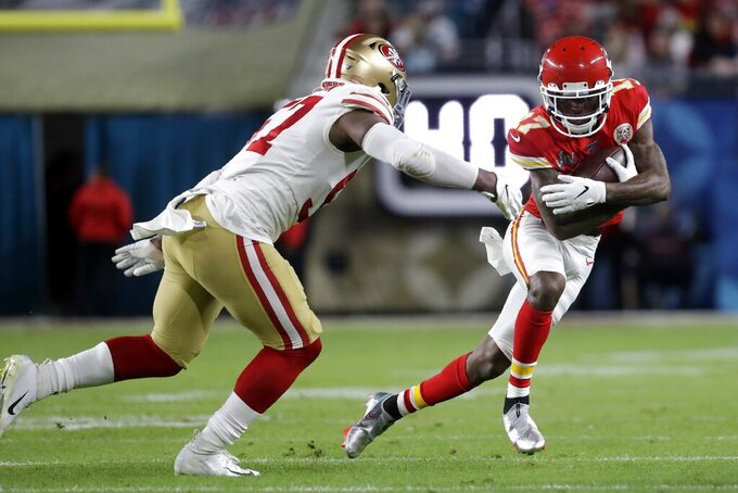 Kansas City Chiefs' Mecole Hardman (17) runs against San Francisco 49ers' Dre Greenlaw during the first half of the NFL Super Bowl 54 football game Sunday, Feb. 2, 2020, in Miami Gardens, Fla. (AP Photo/Wilfredo Lee)
