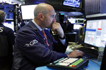 Specialist James Denaro works on the floor of the New York Stock Exchange, Friday, Nov. 9, 2018. Stocks are falling as energy companies are dragged lower by the continuing plunge in crude oil prices. (AP Photo/Richard Drew)