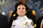 FILE-In this Thursday, Jan. 4, 2018 file photo, Atlanta Police Chief Erika Shields attends a press conference in Atlanta. Legions of police and federal agents will be protecting the stadium as Atlanta hosts Super Bowl 53, but recent attacks in the U.S. and around the world underscore how terrorists are striking less-secure areas outside sports stadiums, arenas and airports, experts say. (AP Photo/David Goldman, File)