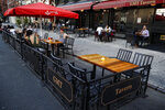 Customers dine outside GMT Tavern, Monday, June 22, 2020, in New York. New York City Mayor Bill de Blasio says he is delaying the planned resumption of indoor dining at restaurants in the city out of fear it would ignite a a spike in coronavirus infections. (AP Photo/John Minchillo)