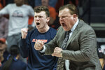 Illinois head coach Brad Underwood and his son Tyler react to Illinois' play against Purdue in the second half of an NCAA college basketball game, Sunday, Jan. 5, 2020, in Champaign, Ill. (AP Photo/Holly Hart)