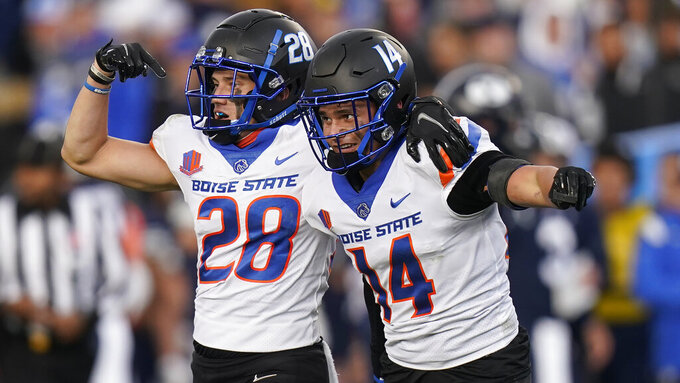 Boise State's Kaonohi Kaniho (14) celebrates after his interception with teammate Kekaula Kaniho (28) during the second half during an NCAA college football game against BYU, Saturday, Oct. 9, 2021, in Provo, Utah. (AP Photo/Rick Bowmer)