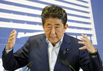 Japan's Prime Minister and leader of the Liberal Democratic Party Shinzo Abe speaks following Sunday's elections results, at the party's headquarter in Tokyo Monday, July 22, 2019. Abe's ruling coalition secured a majority in Japan's upper house of parliament in elections Sunday, but it lost ground and fell short of the super-majority needed to propose constitutional revisions, according to vote counts by public television and other media. (Yohei Kanesashi/Kyodo News via AP)