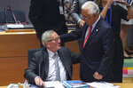 European Commission President Jean-Claude Juncker, left, speaks with Portuguese Prime Minister Antonio Costa during a round table meeting at an EU summit in Brussels, Friday, Oct. 18, 2019. After agreeing on terms for a new Brexit deal, European Union leaders are meeting again to discuss other thorny issues including the bloc's budget and climate change. (Aris Oikonomou, Pool Photo via AP)