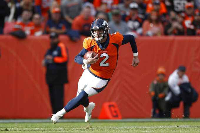 Denver Broncos quarterback Brandon Allen (2) runs the ball against the Cleveland Browns during the first half of NFL football game, Sunday, Nov. 3, 2019, in Denver. (AP Photo/David Zalubowski)