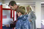Kentucky Attorney General and democratic Gubernatorial candidate Andy Beshear studies his ballot at the Knights of Columbus polling location Tuesday, Nov. 5, 2019, in Louisville, Ky. Kentucky's voters are now deciding the political grudge match between Republican Gov. Matt Bevin and Beshear. (AP Photo/Bryan Woolston)