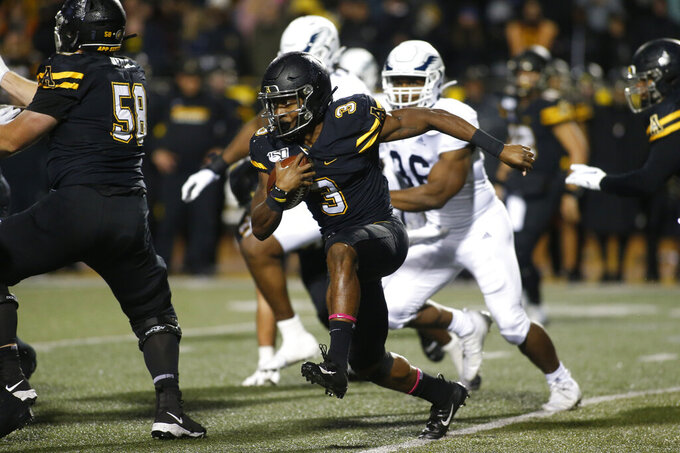 Appalachian State running back Darrynton Evans (3) runs for a first down during the first half of the team's NCAA college football game against Georgia Southern on Thursday, Oct. 31, 2019, in Boone, N.C. (AP Photo/Brian Blanco)