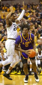 LSU's Naz Reid, right, drives past Missouri's Kevin Puryear, left, during the first half of an NCAA college basketball game Saturday, Jan. 26, 2019, in Columbia, Mo. (AP Photo/L.G. Patterson)