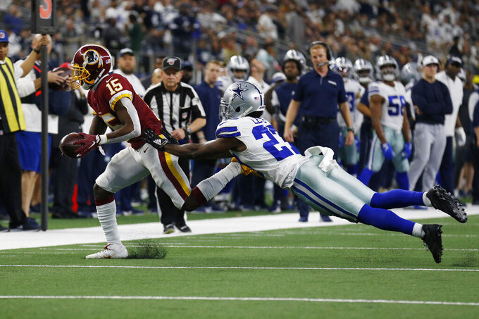 Washington Redskins wide receiver Steven Sims (15) in front of Dallas Cowboys cornerback Jourdan Lewis (27) during the first half of an NFL football game in Arlington, Texas, Sunday, Dec. 15, 2019. (AP Photo/Roger Steinman)