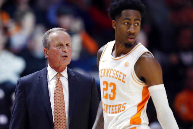 Tennessee head coach Rick Barnes gives direction to guard Jordan Bowden (23) during the second half of an NCAA college basketball game against Florida A&M Wednesday, Dec. 4, 2019, in Knoxville, Tenn. Tennessee won 72-43. (AP Photo/Wade Payne)