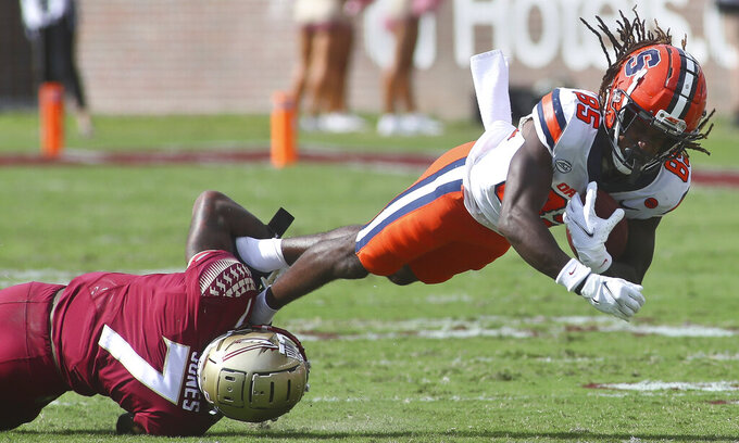 Florida State defensive back Jarrian Jones (7) tackles Syracuse wide receiver Courtney Jackson (85) by his feet after he made a first-down catch in the first quarter of an NCAA college football game, Saturday, Oct. 2, 2021, in Tallahassee, Fla. (AP Photo/Phil Sears)