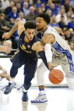 Marquette's Markus Howard (0) tries to drive past Creighton's Davion Mintz (1) during the first half of an NCAA college basketball game in Omaha, Neb., Wednesday, Jan. 9, 2019. (AP Photo/Nati Harnik)