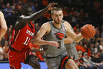 Utah's Both Gach (11) defends against Oregon State's Tres Tinkle (3) during the first half of an NCAA college basketball game in Corvallis, Ore., Thursday, Feb. 13, 2020. (AP Photo/Amanda Loman)