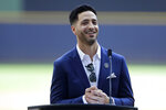 Former Milwaukee Brewers player Ryan Braun smiles as he gives his retirement speech before a baseball game between the Brewers and the New York Mets, Sunday, Sept. 26, 2021, in Milwaukee. (AP Photo/Aaron Gash)