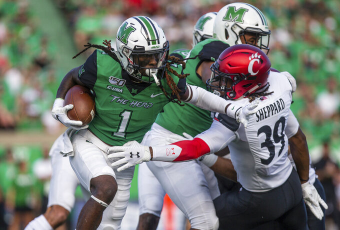 Marshall's Willie Johnson (1) attempts to get past Cincinnati's Jaquan Sheppard (39) on a kickoff return an NCAA college football game on Saturday, Sept. 28, 2019, in Huntington, W.Va. (Sholten Singer/The Herald-Dispatch via AP)