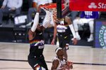 Denver Nuggets forward Paul Millsap (4) dunks over Los Angeles Lakers' Rajon Rondo (9) during the second half of Game 3 of the NBA basketball Western Conference final Tuesday, Sept. 22, 2020, in Lake Buena Vista, Fla. (AP Photo/Mark J. Terrill)