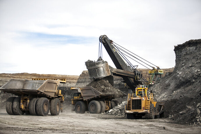 FILE - In this Jan. 9, 2014, file photo, a shovel loads haulers with coal at the Antelope Mine north of Douglas, Wyo. A coalition of U.S. states, environmentalists and an American Indian tribe are seeking to revive a moratorium on coal sales from public lands in the West. (Ryan Dorgan/The Casper Star-Tribune via AP, File)