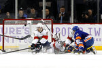 New York Islanders center Mathew Barzal (13) shoots the puck past Florida Panthers center Colton Sceviour (7) and goaltender Sergei Bobrovsky (72) for a goal during the first period of an NHL hockey game, Saturday, Nov. 9, 2019, in New York (AP Photo/Jim McIsaac)