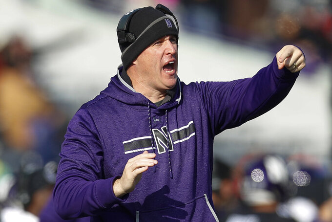 Northwestern coach Pat Fitzgerald calls out a play during the first half of an NCAA college football game against Massachusetts, Saturday, Nov. 16, 2019, in Evanston, Ill. (AP Photo/Jim Young)
