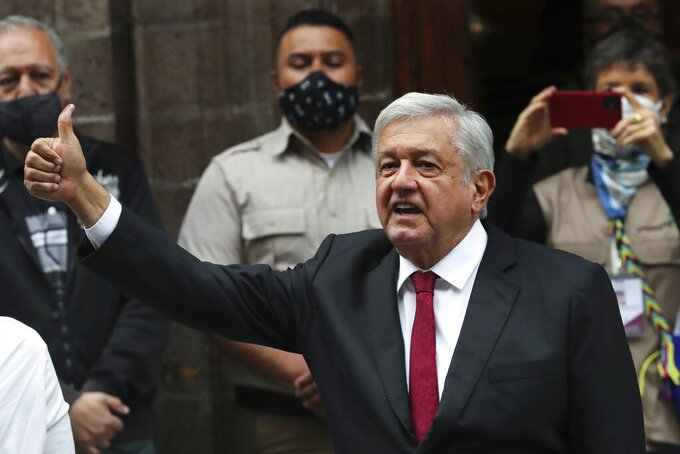 Mexico's President Andres Manuel Lopez Obrador thumbs up after voting in congressional, state and local elections in Mexico City, Sunday, June 6, 2021. Mexicans on Sunday were electing the entire lower house of Congress, almost half the country's governors and most mayors in a vote that will determine if  Obrador's Morena party gets the legislative majority. (AP Photo/Marco Ugarte)