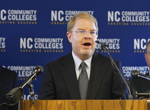 FILE - In this May 1, 2018, file photo, Peter Hans, the newly elected president of the N.C. Community College System, delivers remarks during a news conference in Raleigh, N.C. North Carolina's community college system president will become the next head of the University of North Carolina's 17-campus system, a UNC governing board member said on Thursday, June 18, 2020. (AP Photo/Gerry Broome, File)