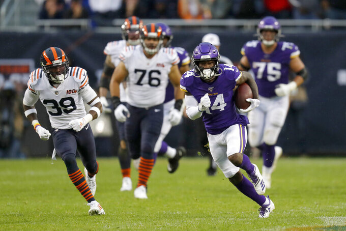 Minnesota Vikings wide receiver Stefon Diggs (14) runs with the ball as Chicago Bears free safety Eddie Jackson (39) gives chase during the second half of an NFL football game Sunday, Sept. 29, 2019, in Chicago. (AP Photo/Charles Rex Arbogast)