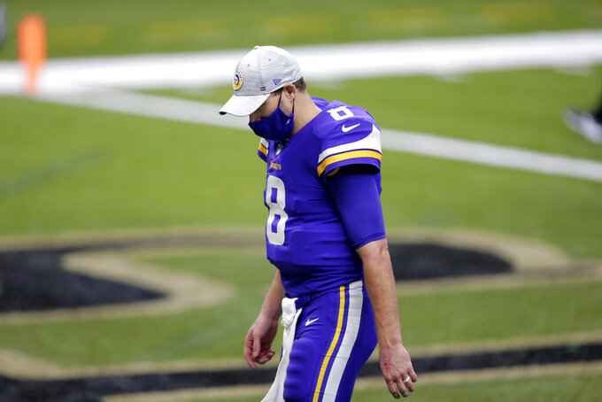 Minnesota Vikings quarterback Kirk Cousins (8) walks off the field after an NFL football game against the New Orleans Saints in New Orleans, Friday, Dec. 25, 2020. The Saints won 52-33. (AP Photo/Brett Duke)