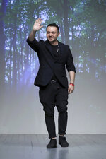Designer Bora Aksu accepts applause at the end of his Spring/Summer 2019 runway show at London Fashion Week in London, Friday, Sept. 14, 2018. (Photo by Grant Pollard/Invision/AP)