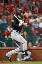 Pittsburgh Pirates' Colin Moran follows through on an RBI single during the ninth inning of the team's baseball game against the St. Louis Cardinals on Tuesday, July 16, 2019, in St. Louis. (AP Photo/Jeff Roberson)