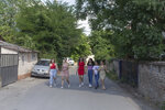 """From left, Silvia Sinani, 24, Dijana Ferhatovic, 18, Zivka Ferhatovic, 20, Elma Dalipi, 14, Selma Dalipi, 14, and Zlata Ristic, 27, members of the Pretty Loud band, walk along a street in their neighborhood in Belgrade, Serbia, Wednesday, June 16, 2021. A female Roma, or Gypsy, band in Serbia has used music to preach women's empowerment within their community. Formed in 2014, """"Pretty Loud"""" symbolically seeks to give a louder voice to Roma girls, encourage education and steer them away from the widespread custom of early marriage. (AP Photo/Marko Drobnjakovic)"""