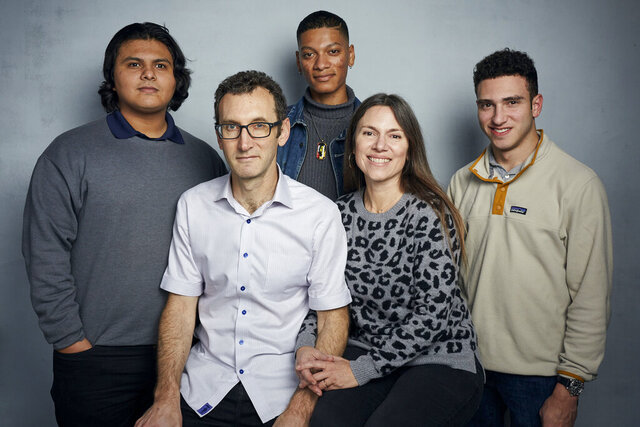 FILE - Steven Garza, from left, director Jesse Moss, Rene Otero, director Amanda McBaine and Ben Feinstein pose for a portrait to promote the film