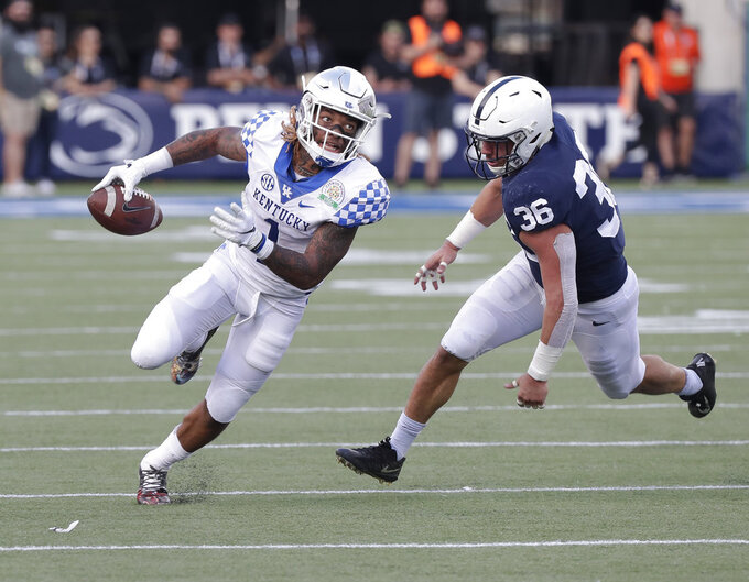 Kentucky wide receiver Lynn Bowden Jr., left, tries to get past Penn State linebacker Jan Johnson (36) during the second half of the Citrus Bowl NCAA college football game, Tuesday, Jan. 1, 2019, in Orlando, Fla. (AP Photo/John Raoux)