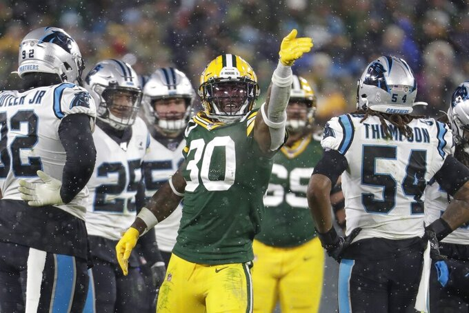 Green Bay Packers' Jamaal Williams reacts to his first down run during the second half of an NFL football game against the Carolina Panthers Sunday, Nov. 10, 2019, in Green Bay, Wis. (AP Photo/Morry Gash)