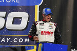 A.J. Allemdinger celebrates after winning the NASCAR Xfinity Cup Series auto race at Michigan International Speedway, Saturday, Aug. 21, 2021, in Brooklyn, Mich. (AP Photo/Carlos Osorio)