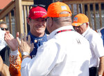 Scott Dixon, left, celebrates with his car owner Chip Ganassi after winning an IndyCar Series auto race, Sunday, July 28, 2019, at Mid-Ohio Sports Car Course in Lexington, Ohio. (AP Photo/Tom E. Puskar)